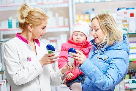 Mom with toddler at pharmacy